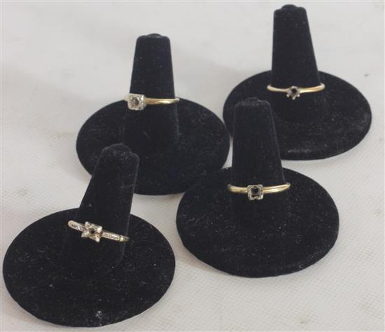 FOUR MARKED 14KT GOLD RING MOUNTS. SIZES: 6.5, 5.5, 7, AND 5. 6.7 GRAMS TW.