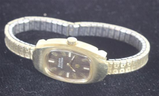 MARKED 14KT GOLD ACCUTRON BY BULOVA. ANALOG WITH UNNUMBERED FACE MARKED
