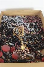 BOX LOT DARK BEADED COSTUME JEWELRY INCLUDING: DESIGNER COSTUME JEWELRY, METALLIC BEAD STRANDS, AND A GOLD TONE AND WOOD NECKLACE WI...