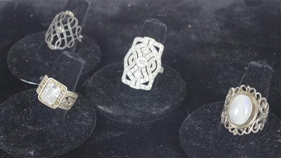 FOUR STERLING SILVER RINGS INCLUDING: SIZE 4.5 OPENWORK WITH CLEAR STONE ACCENTS AND RECTANGULAR CUT PRONG SET CZ CENTER STONE, SIZE...