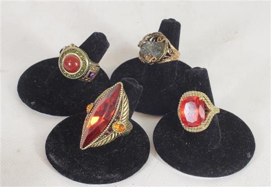 FOUR RINGS INCLUDING: TWO HEIDI DAUS DESIGNER RINGS WITH COLORED CRYSTALS AND ORNAMENTAL SHANKS SIZES 4.5 - 5, SIZE 5 OPENWORK STERL...