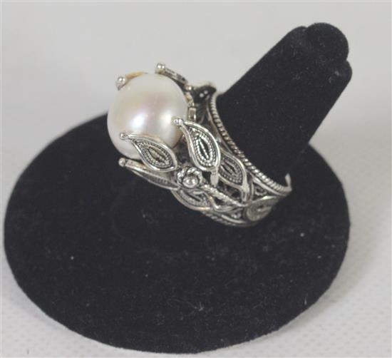 ART NOVEAU STYLE SIZE 5 TURKISH MADE STERLING SILVER AND PEARL SOLITAIRE RING ON FILIGREE SHANK WITH FLORAL MOTIF. 0.32 TROY OUNCES TW.