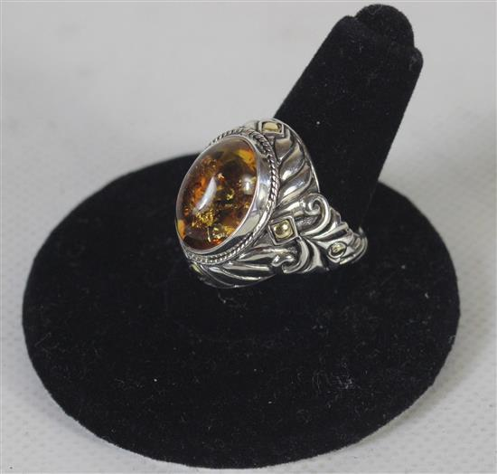18KT WHITE GOLD SIZE 6 RING WITH STRAIGHT ENGRAVED SHANK AND MILGRAIN BEZEL SET AMBER CABACHON. 7.4 GRAMS TW.