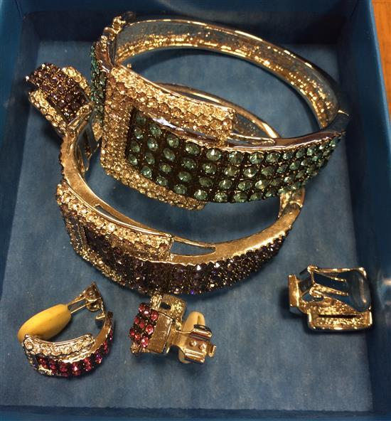 TWO DUAL TONE HINGED BUCKLE CUFFS WITH DUAL TONE PAVE SET STONES. BRUSHED METAL WITH BOX CLASPS AND TWO PAIR MATCHED SNAP BACK EARRI...