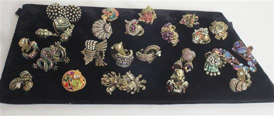 23 PAIR EARRINGS. MOSTLY BRUSHED GOLD TONE SNAPBACKS WITH INSET COLORED CRYSTALS BY HEIDI DAUS.