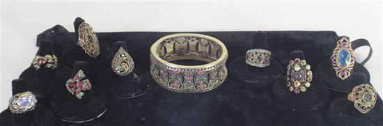 LOT OF NINE RINGS AND ONE CUFF INCLUDING: GOLD TONE HINGED CUFF WITH COLORFUL PAVE SET CRYSTALS, STERLING SILVER SIZE 8 RING WITH 21...