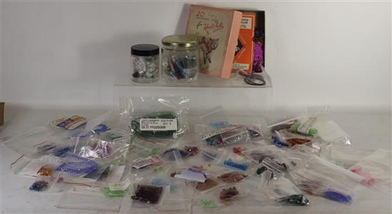 BOX LOT BEADING AND JEWELRY MAKING SUPPLIES INCLUDING: LOOSE AND ASSORTED COLORFUL BEADS AND SEED BEADS.