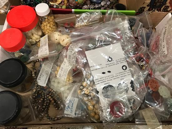 BOX LOT BEADING AND JEWELRY MAKING SUPPLIES INCLUDING: STONE, CARVED, AND WOODEN BEADS. SOME FIGURAL, MOST WITH ASIAN MOTIF.