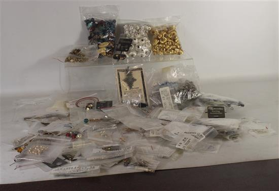 BOX LOT BEADING AND JEWELRY MAKING SUPPLIES INCLUDING: SILVER AND GOLD PLATED BEADS, GOLD FILLED WIRE, AND FASHION EARRINGS ON CARDS.
