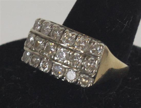 MARKED 14KT GOLD RING. SIZE 7 WITH BENT SHANK AND 18 DIAMONDS IN SHARED PRONG SETTING. 6.6 GRAMS TW.