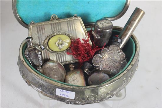 EIGHT SILVER TONE PIECES INCLUDING SOME STERLING SILVER WITH: ONE ENGRAVED STERLING PERFUME BOTTLE WITH DAUBER, TWO STERLING BOTTLES...