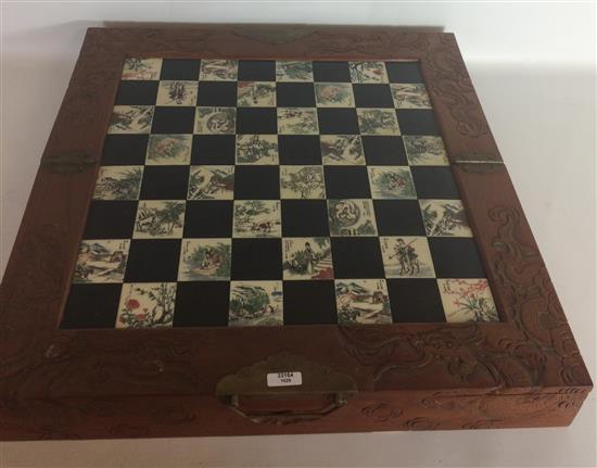 CARVED ASIAN FOLDING CHESS SET WITH PAINTED STONE AND BLACK STONE PLAYING SURFACE, 32 CARVED PLAYING PIECES KEPT IN 2 DRAWERS, 18.5
