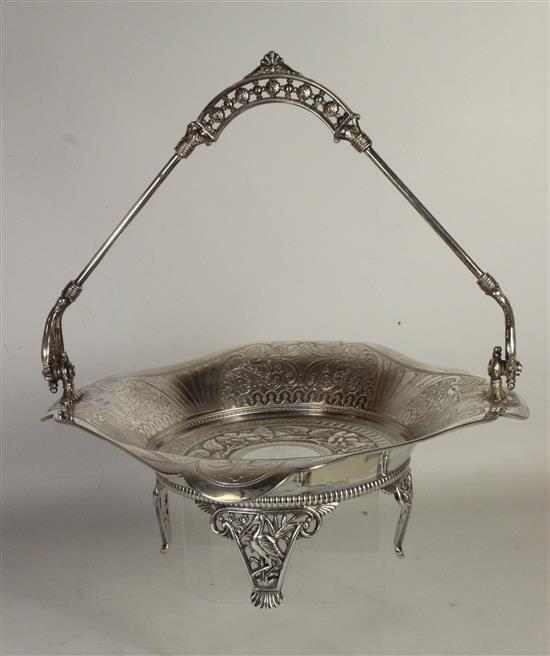 SILVER TONE HOLLOWARE FOOTED DISH WITH BROKEN HINGED HANDLE AND FLORAL MOTIF 4.5