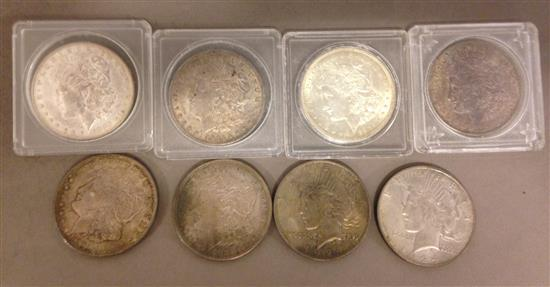 †8 U.S. SILVER DOLLARS INCLUDING 1882, (4) 1921 AND 1921D MORGAN AND (2) 1924 PEACE *tax exempt*