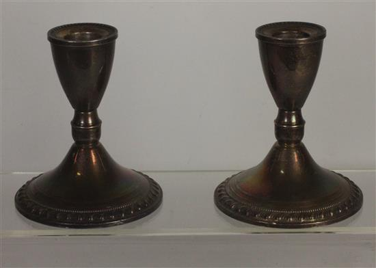 PAIR STERLING WEIGHTED CANDLESTICK BASES MEASURING APPROXIMATELY 4