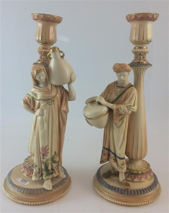 PAIR ROYAL WORCESTER BLUSH IVORY CANDLESTICKS WITH WATER CARRIER FIGURES, STAMPED