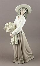 NAO BY LLADRO FIGURINE OF WOMAN HOLDING WHEAT, 15.25