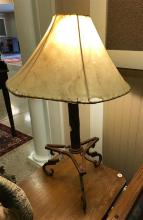 CAST IRON TABLE LAMP WITH TRIPOD BASE AND SHEEPSKIN SHADE, 31