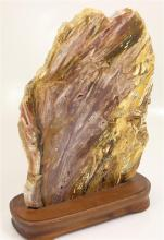 POLISHED ROCK SPECIMEN WITH AREAS OF DRUZY ON WOOD STAND, 12
