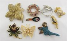 9 COSTUME PINS INCLUDING MOSAIC, FLORAL AND CHERUB