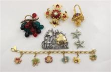 LOT COSTUME JEWELRY INCLUDING PINS, FLORAL CHARM BRACELET AND STARFISH CLIP EARRINGS