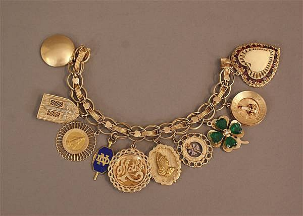 14 K YELLOW GOLD FANCY HEART LINK CHARM BRACELET WITH (10) CHARMS