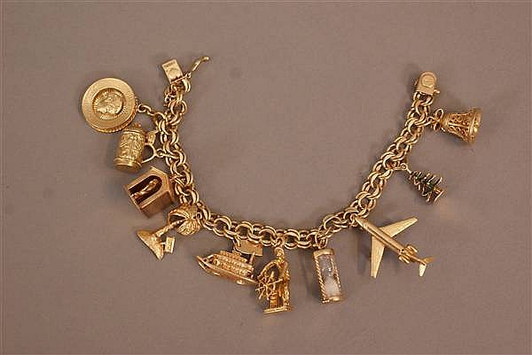 14 K YELLOW GOLD CHARM BRACELET WITH (11) CHARMS