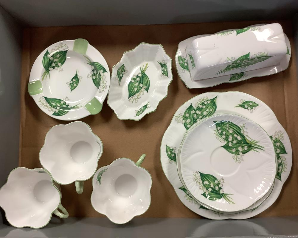 """Lot of Shelley """"Lily of the Valley"""" 11 pieces, 3 cups, ashtray, butter tray and cover, mint tray, 3 sauces and 1 dessert plate."""