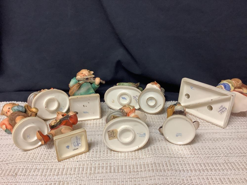 """Lot of nine Hummel figurines ranging from 5 to 9"""" tall, some marked Goebel Germany, and also W. Germany."""