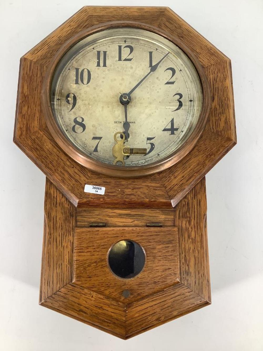 "Seth Thomas mini schoolhouse clock in oak case. 18""H"
