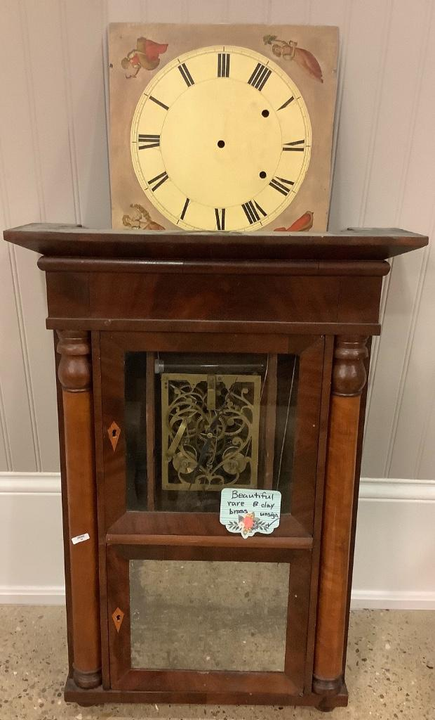 """Mahogany half pilaster mantle clock with unusual brass heart shaped movement, eight day. 30""""H"""