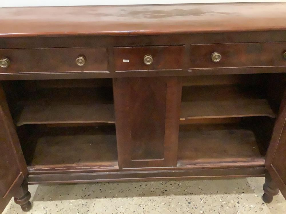 Cherry and mahogany empire sideboard with full turned pilasters., 64x23x44.