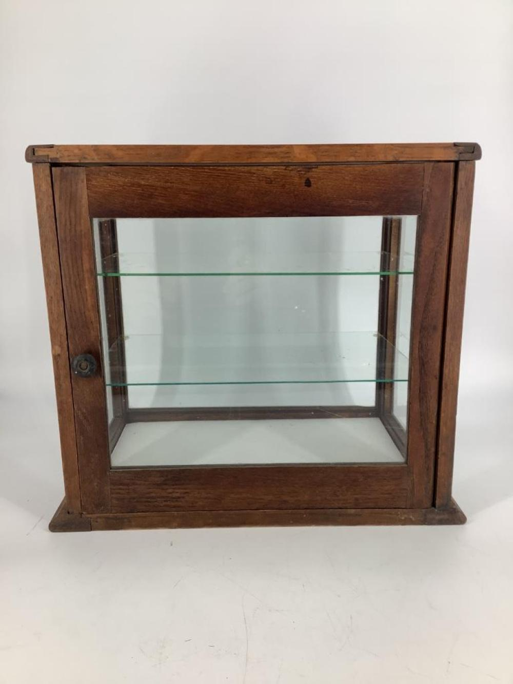 Small three-shelf glass and oak display case. 15x11x15in .
