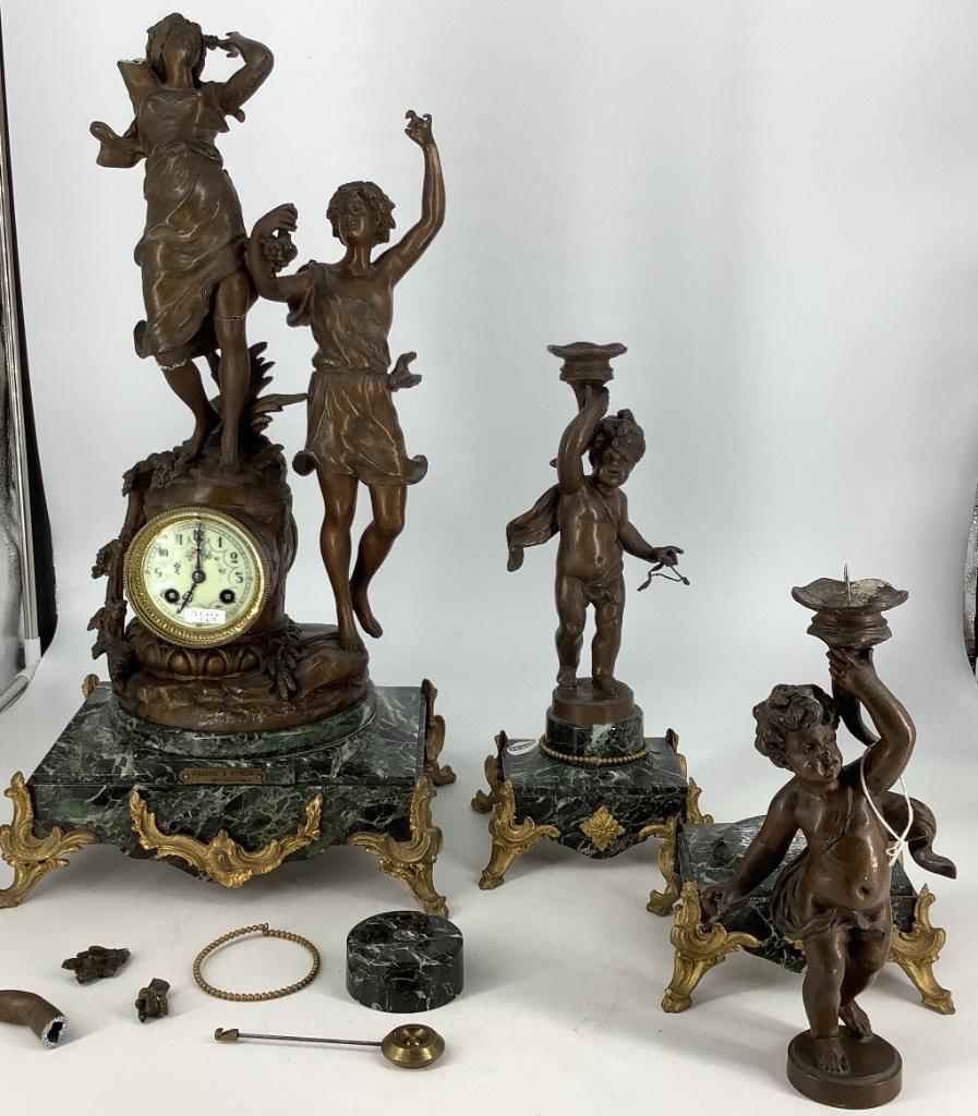 "Spelter 3 piece clock set, vendang and moisson, damage to top figure, 23""H"