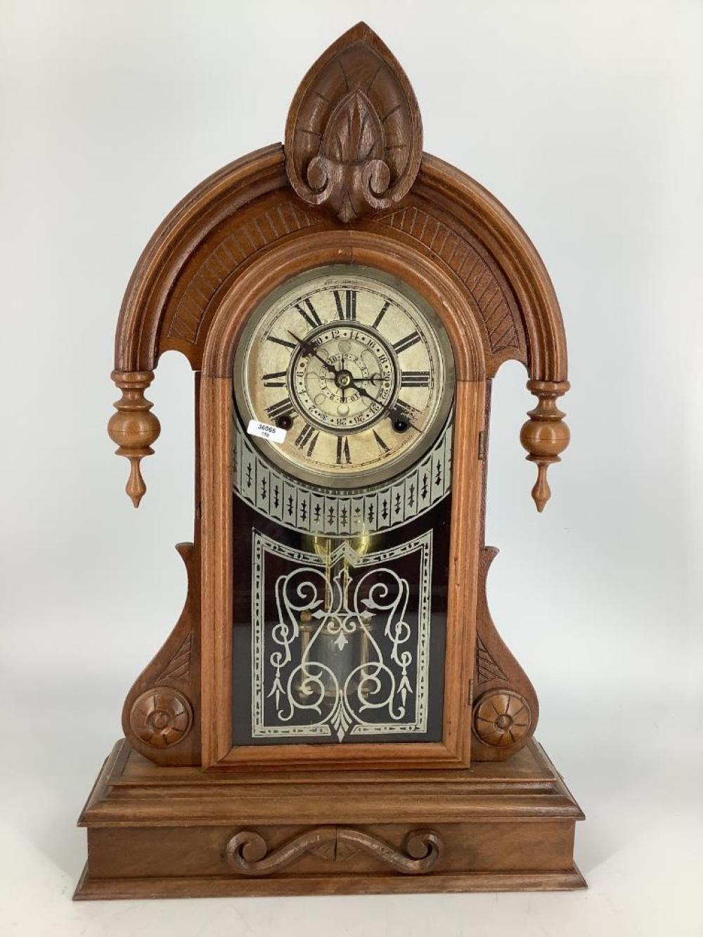 "William Gilbert walnut Victorian mantle clock with calendar dial. 22""H"