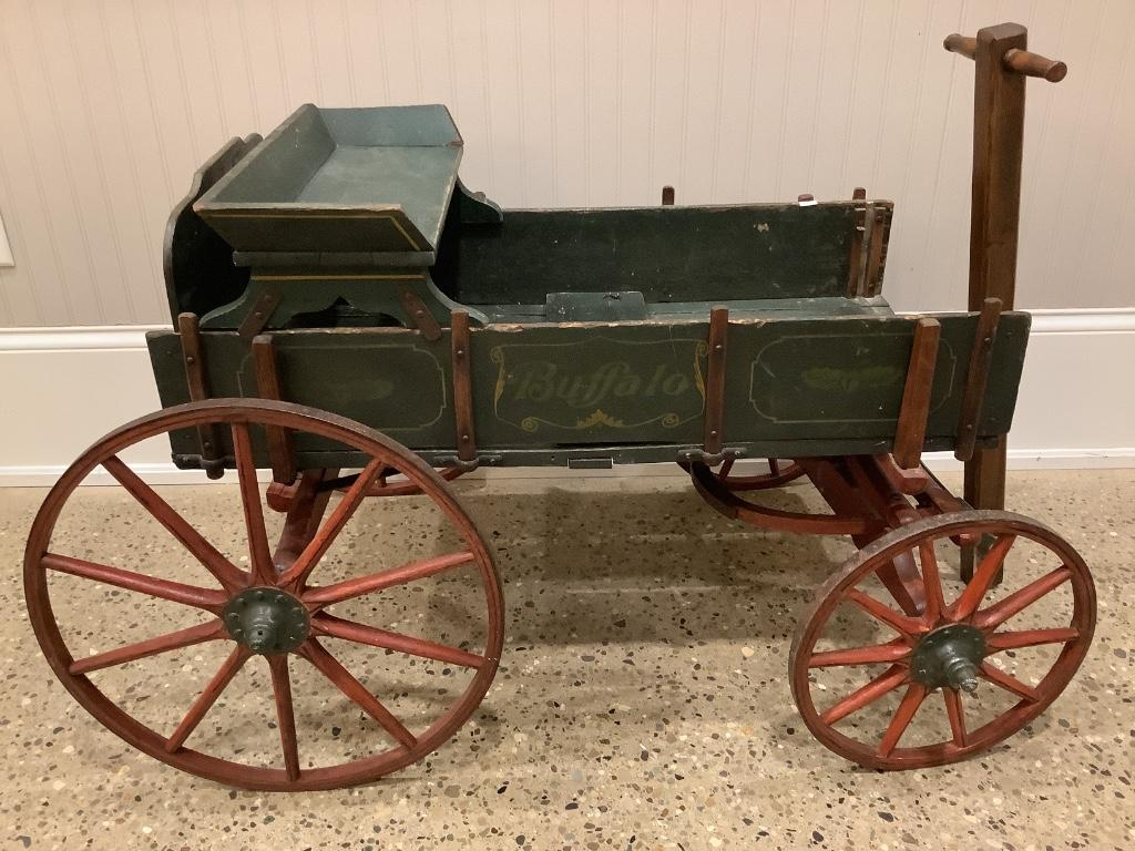 Buffalo child's wagon with wooden wheels, seat, original paint., 45x27x27in .