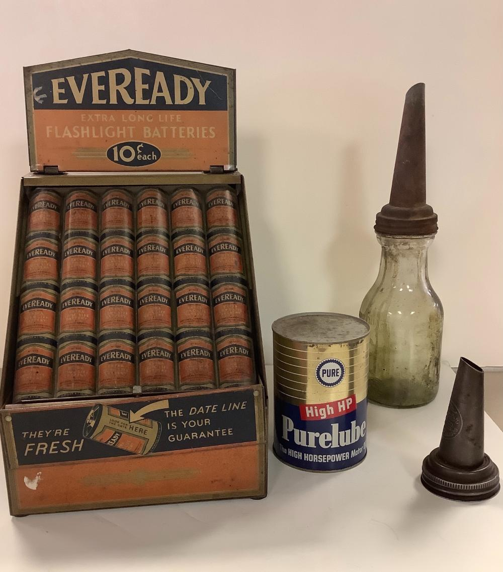 Lot including battery display and oil jar.