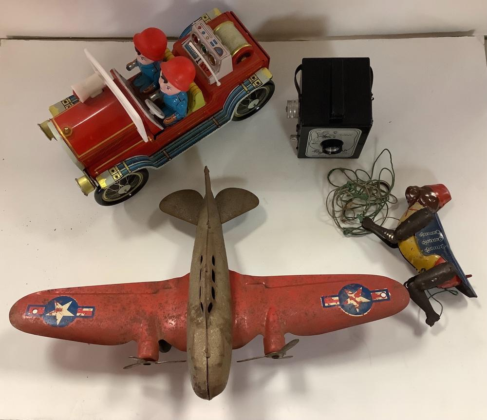 Lot of vintage toys including Roy Rogers camera and metal airplane