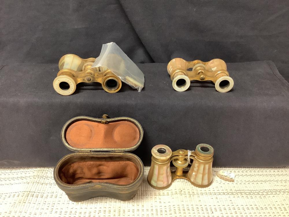 """Lot of three mother of pearl opera glasses, two with parts missing (some parts included separately). One retains its case, complete one is marked """"France."""""""