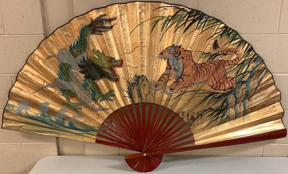 "Decorative fan showing a dragon & tiger. 34""x61"""