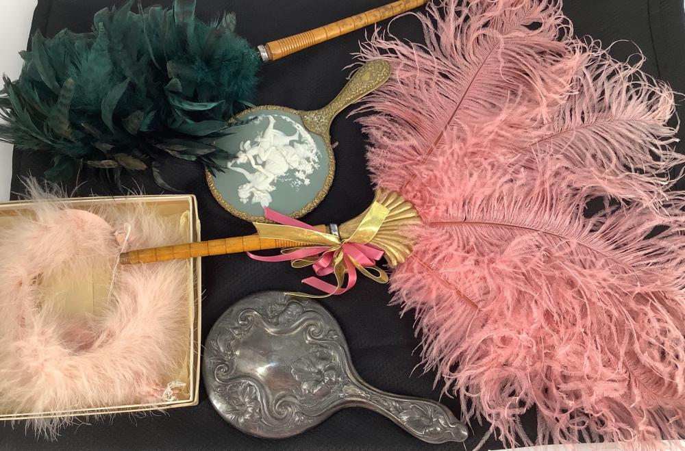 Lot of feather fans,two hand mirrors. Feather collie and a black sweater with white pearls size small.