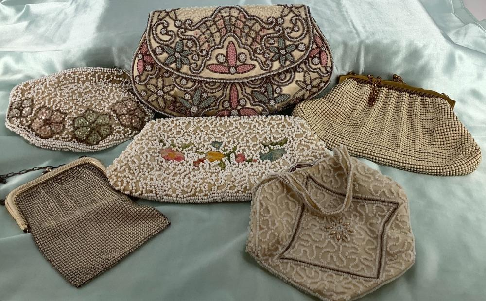 Lot of six vintage purses. Includes a Whting & Davis cream color enamel bag, a lovely silk and pastel colored clutch which was made in France, a small beaded purse with beaded handle which was made in France, another ...