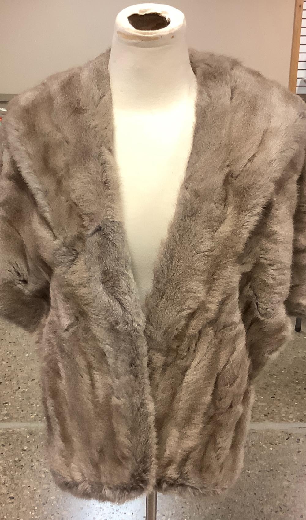 Gray mink stole looks like a small.