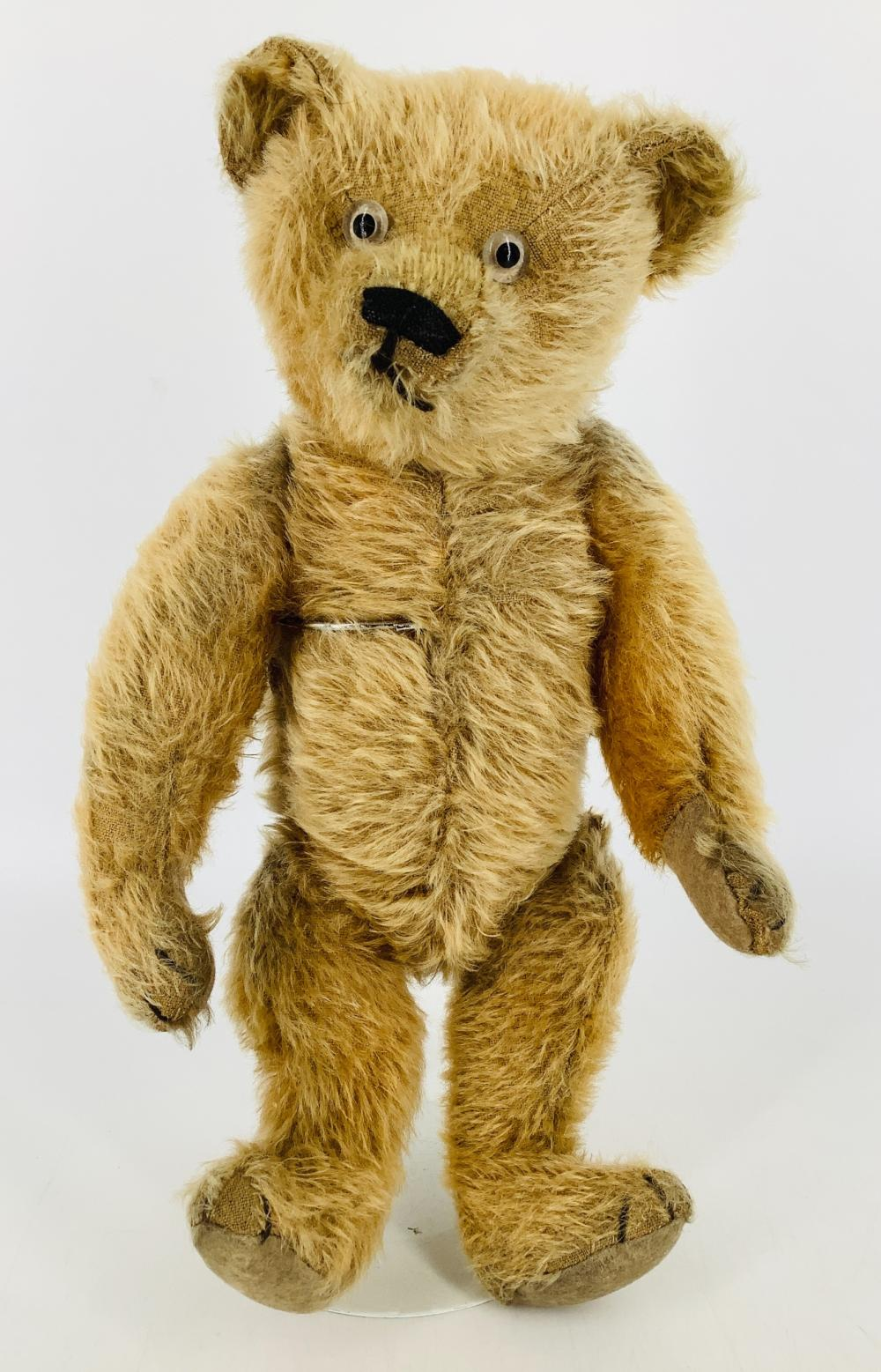 """Vintage mohair teddy bear. 14"""" bear, unknown origin, disk jointed at neck, shoulders and hips, applied ears, stitched nose, glass eyes, felt paw pads. In overall good condition with almost no loss to mohair. unusual j..."""
