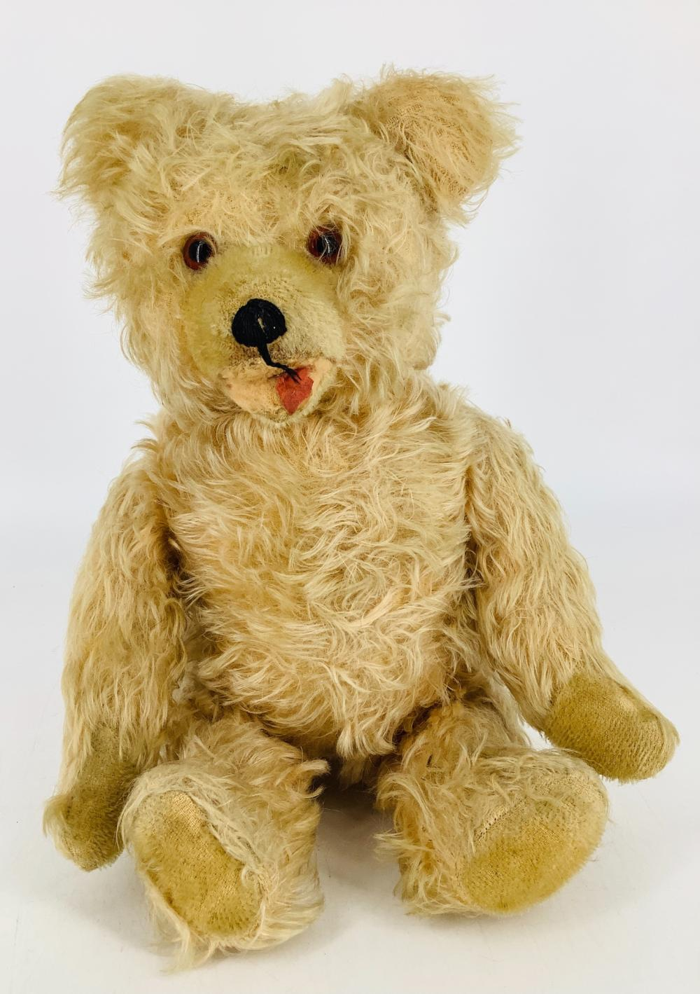 """Vintage blonde mohair teddy bear. 14"""" Zotty-type bear with applied ears, glass eyes, shaved snout with stitched nose, open mouth, firmly straw stuffed body with disk jointed neck, shoulders and hips, shaved mohair paw..."""