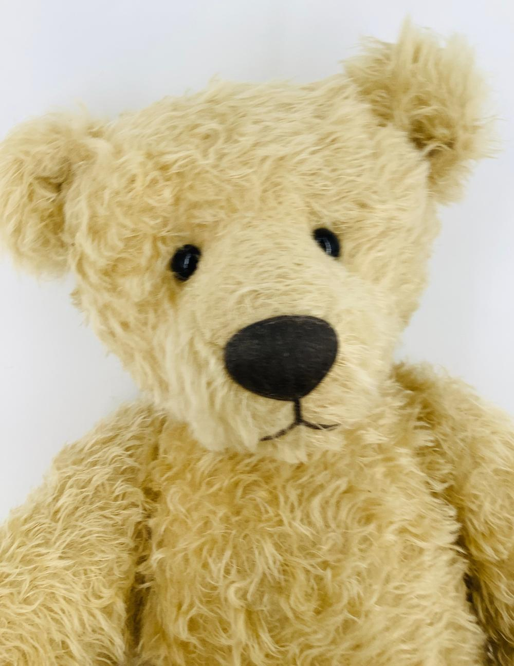 """Wonderful large artist made Teddy Bear. 29"""" blonde mohair bear tagged """"Pamela Wooley Collection"""", glass eyes, applied ears, stitched nose, disk jointed neck, shoulders and hips, suede cloth paw pads."""