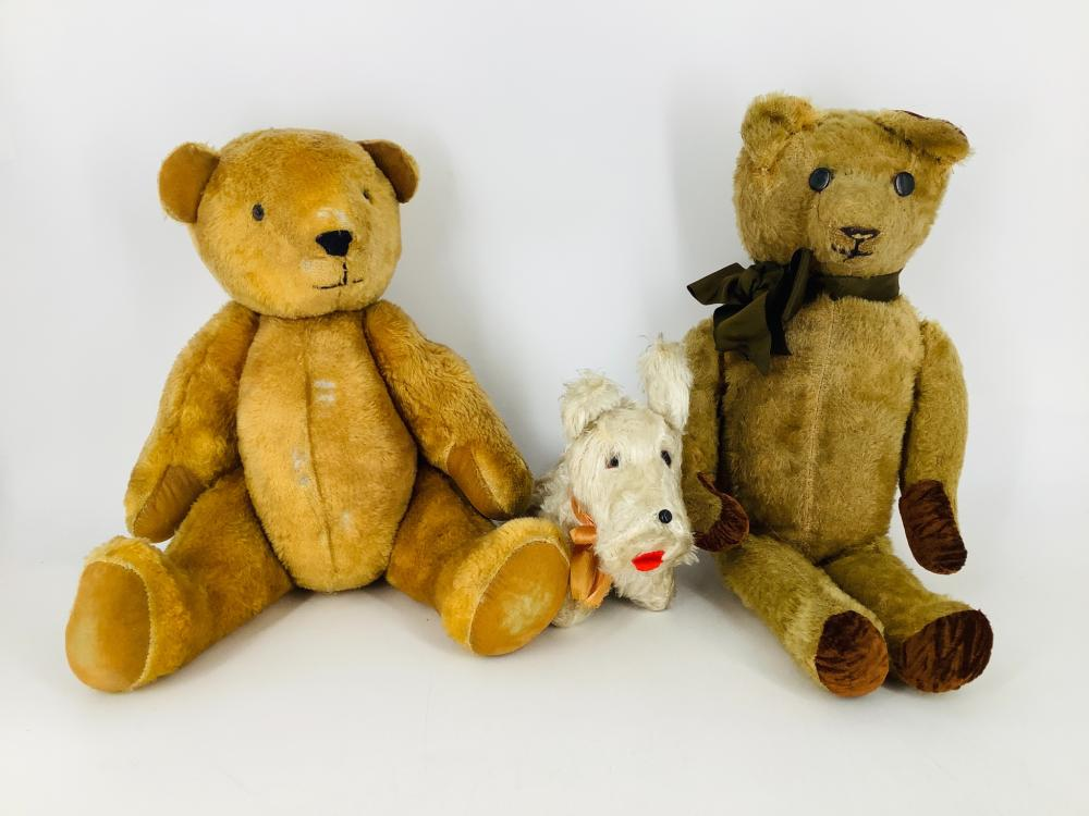 """Lot including (2) vintage teddy bears and a terrier. Includes 16"""" gold cotton plush bear, 18"""" mohair bear and white plush terrier with nose that squeaks when pressed. All are in played-with condition."""