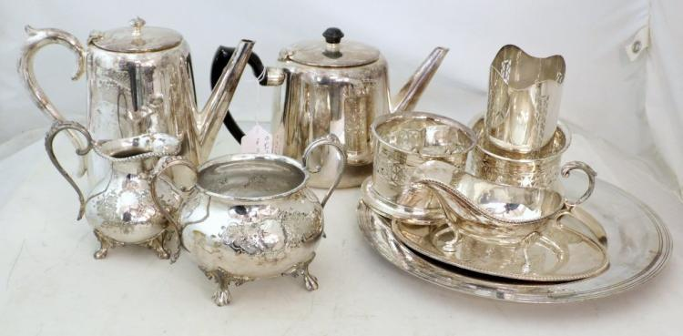 A Collection of Silver Plate EPNS to include, a teapot, hot water jug, sugar bowl, milk jug, a pair of Henniger pierced bottle holders, a sauce boat/stand and a dish. (11 items).