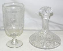 A 19th Century Celery Glass with frieze cut ovals  and stars on a baluster column and circular base.  Also a cut crystal ships decanter and stopper.  Height 25cm. (2 items).