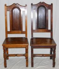 A pair of 17th Century Oak Side Chairs. Having  panel back with an arched scrolling top rail  embraced by scroll finials. Solid seat raised on  block and turned legs joined by rectangular  stretchers. One chair later restoration. Height 46  inches.  (2 Items)